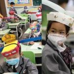 China Students Wear Social Distancing Headgears to Class as Schools Resume