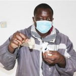 Man shows off three used condom he allegedly found in his wife's car