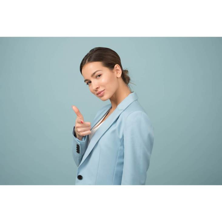 How to develop better self-esteem |  A Young good-looking businesswoman is pointing a finger at you