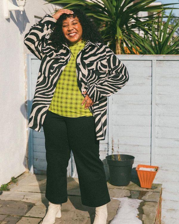 @nicoleocran wearing a printed top and clashing zebra shacket.