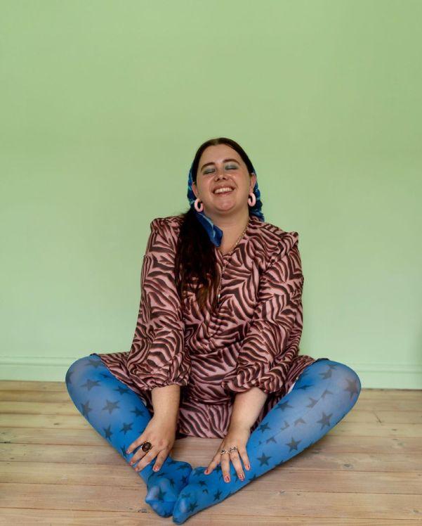 sara brown wearing star-print tights and a printed dress