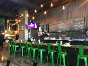 Unlike the rugged exterior, Noble Beat Brewing has a bright interior with a visible kitchen and overall metallic vibe.