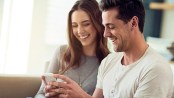 I couple looks at an app on a phone