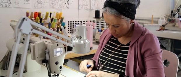 woman sitting at sewing machine