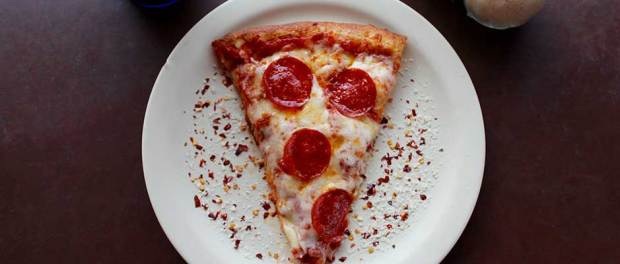 sliced-pepperoni-pizza-on-white-ceramic-plate-708587-scaled