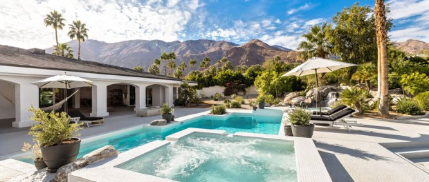 outside a home featuring a pool and hot tub - Pacaso Real Estate
