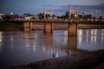 Dusk on the Acre River, in Rio Branco, a sleepy city in the heart of the rich Amazonian rainforest. Rio Branco sprang up out of the jungle less than a hundred years ago as a rubber tapping outpost.