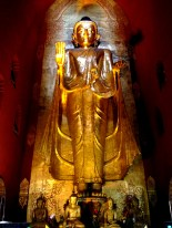 A statue of the Buddha hidden inside a large temple.