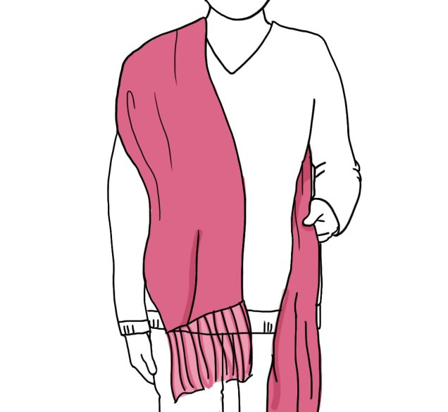 Using a large (tres cuartos, also known as Size 2) rebozo, place it over one shoulder, leaving one end much longer than the other.