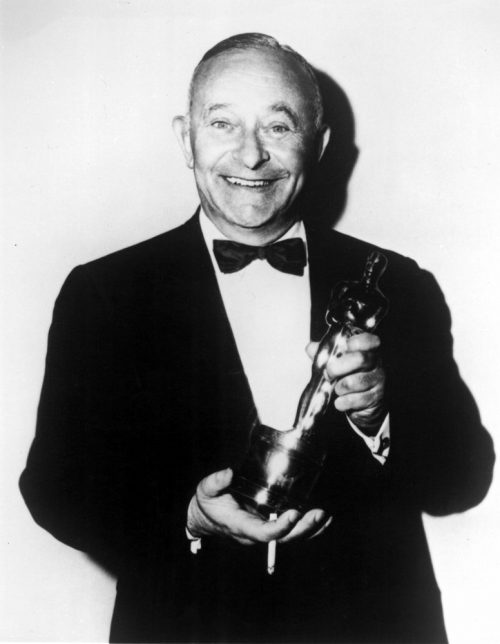 1958: ARTHUR FREED [BEST PICTURE, GIGI] BEAMS AS HE DISPLAYS HIS NEW OSCAR, 1959