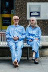 A man and a woman sat on a bench.