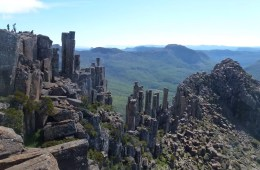 Highlights Of The Overland Track (VIC) The Acropolis - Emily Barlow, Photo Sarah Barlow, rock formations, columns, group of hikers, rest stop with a view