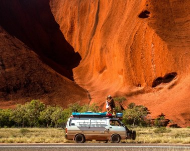 What We Learnt From 4 Years On The Road // Van Life Revisited, mitch cox, Uluru love mitch, rooftop, couple, red rock