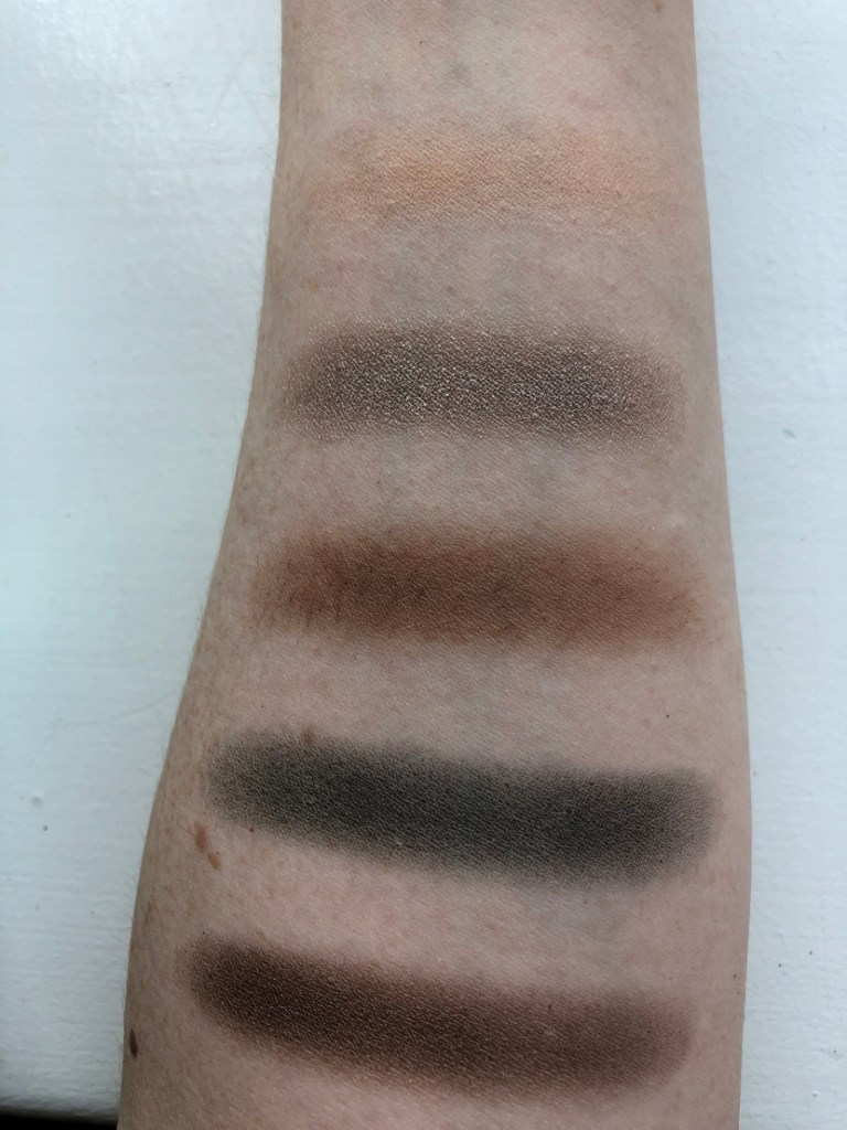 Swatches of first row of Morphe Jaclyn Hill Dark Magic Palette