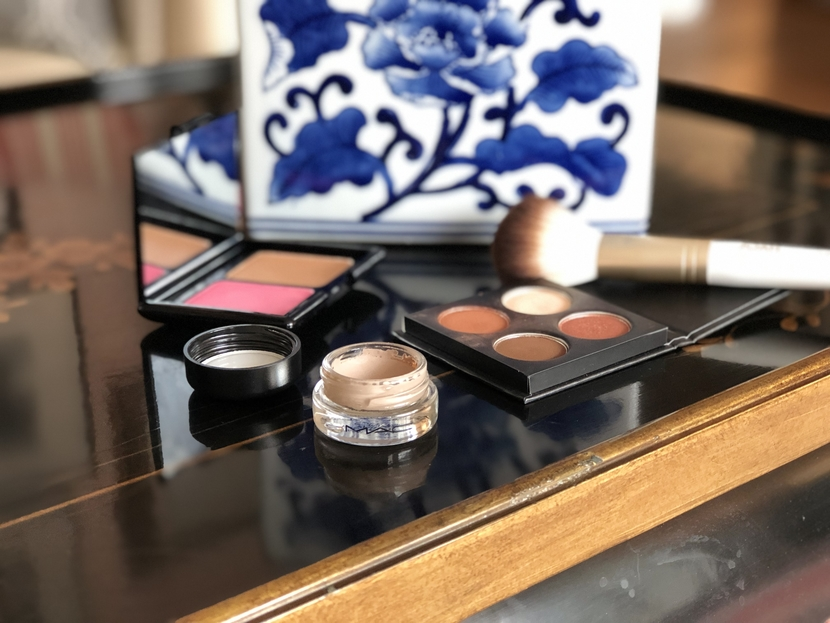 Portrait of MAC Paint Pot in Camel Coat with other makeup products