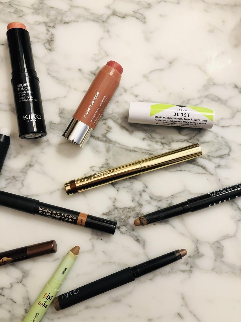 Flatlay with stick makeup from Kiko, Clinique, Arrow Beauty, By Terry, Nudestix, Bobbi Brown & NARS