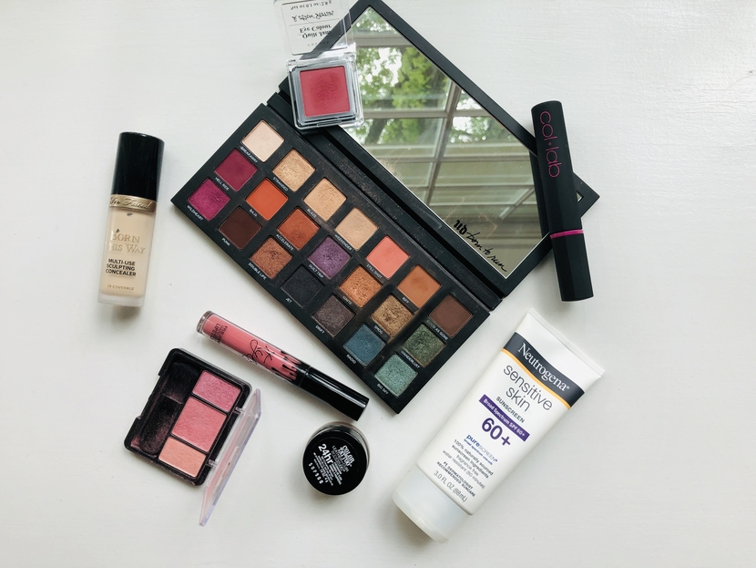 Flatlay with Urban Decay Born to Run Palette, and other summer beauty must-haves