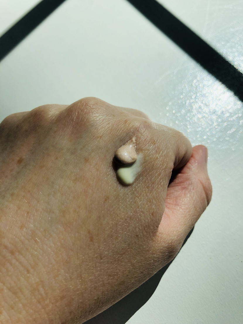 Mixture of L'Oreal Lumi Glotion & Weleda Skin Food Light on back of my hand