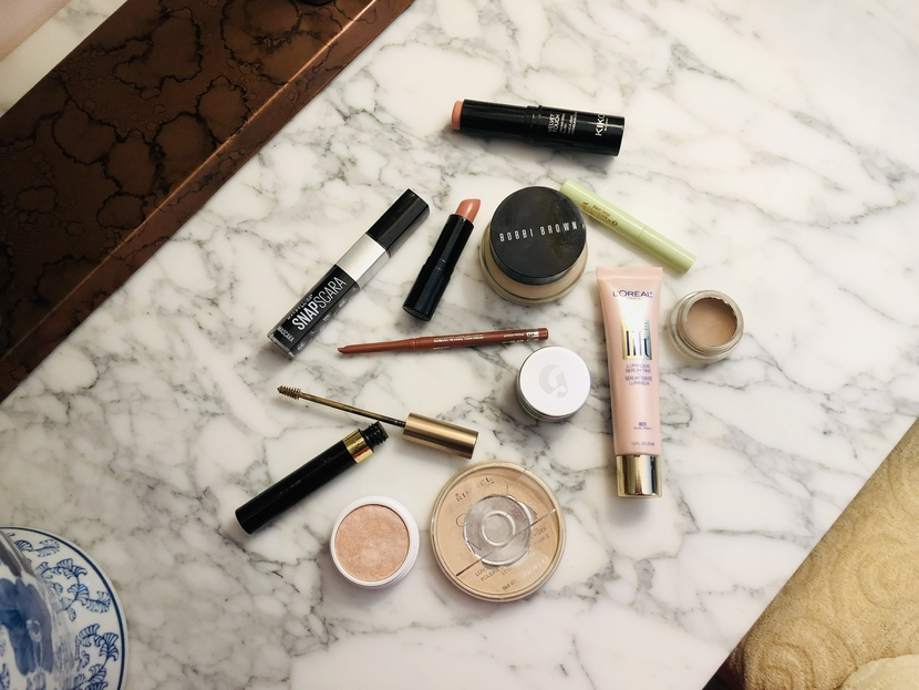 Flatlay featuring products used to achieve a nude makeup look