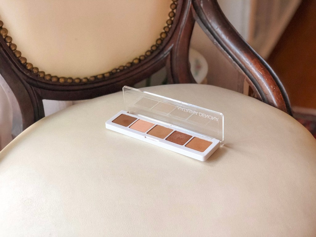 Natasha Denona Camel Palette posed on chair