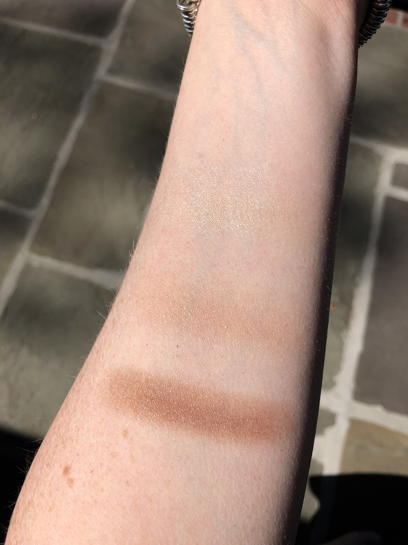 Swatches from the Lune + Aster Supermoon Bronzer & Glow Palette, with highlighter at top, illuminator in middle, and bronzer at bottom.