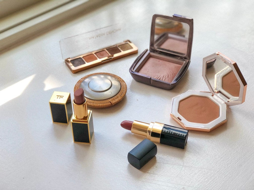 Flatlay with luxury beauty products - where to save on beauty