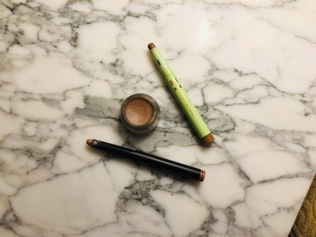 Flatlay with my fave no-eyeshadow eyeshadows from MAC, Pixi, and Laura Mercier