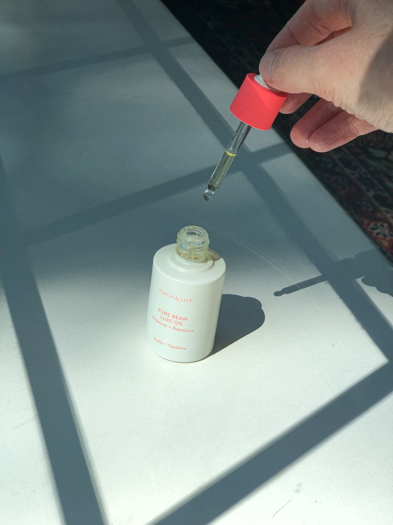 Image showing pipette on the Peach & Lily Pure Beam Luxe Oil
