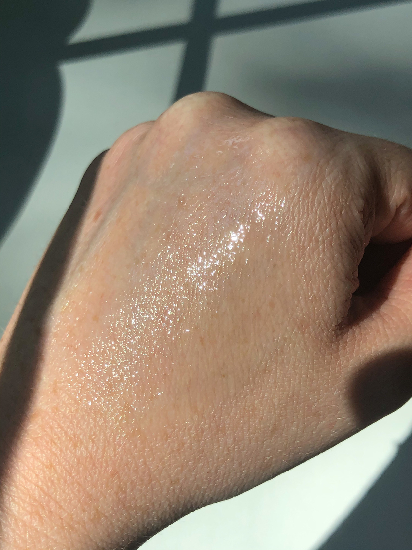 Image showing consistency of the Peach & Lily Pure Beam Luxe Oil on the back of my hand