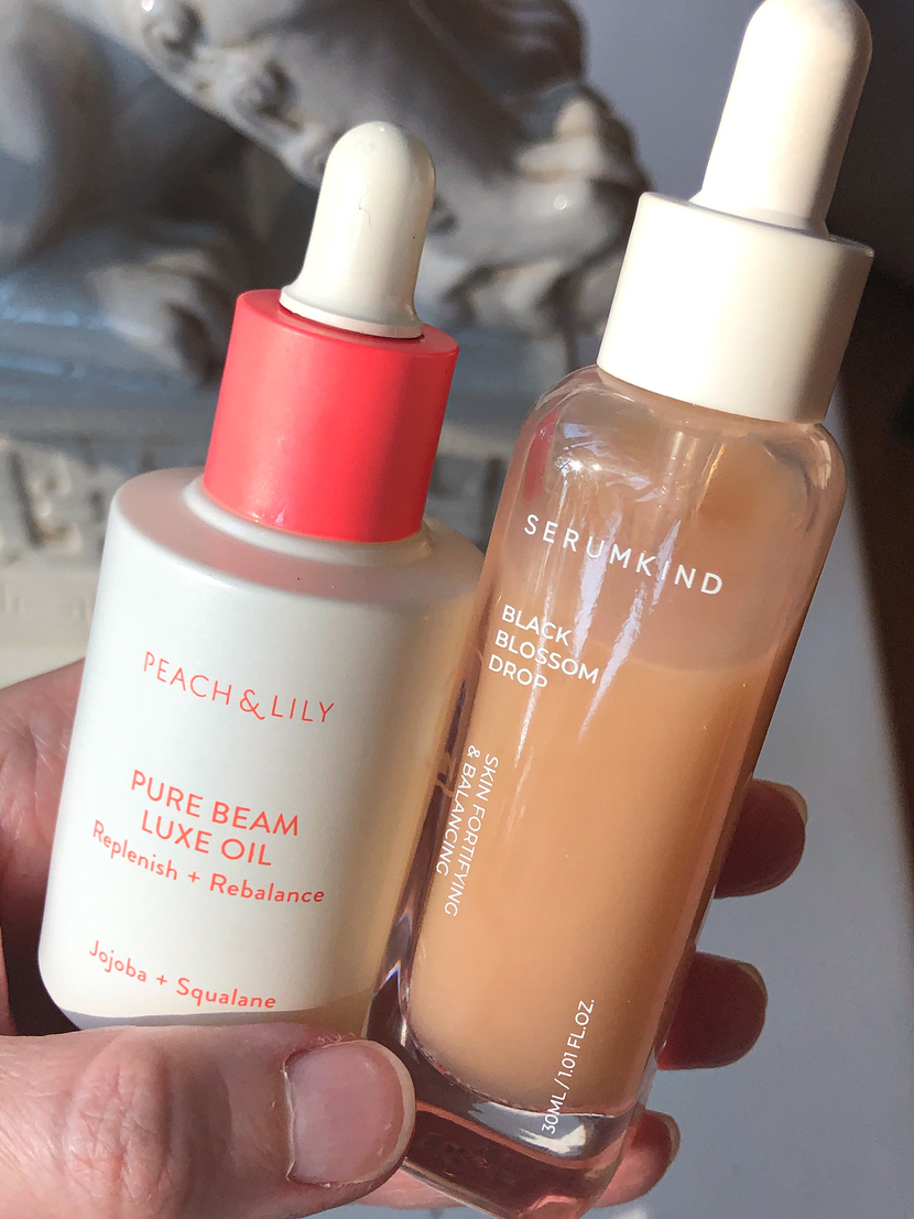 ingredients for super glossy skin, including a serum and face oil