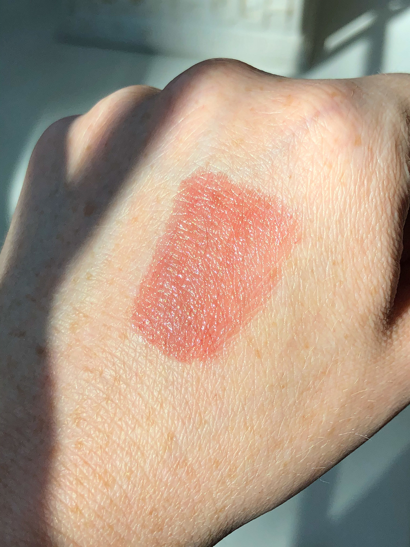 Swatch of the shade Pulse, a warm strawberry