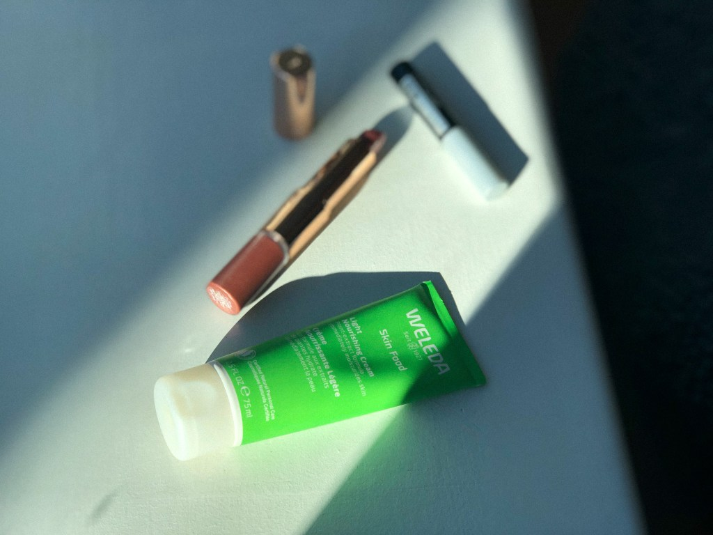 Three of my most used beauty products right now, including Weleda Skin Food Light, Maybelline Brow Fast Sculpt in clear, and Flower Beauty Mix n' Matte Lip Duo in Honey Nude