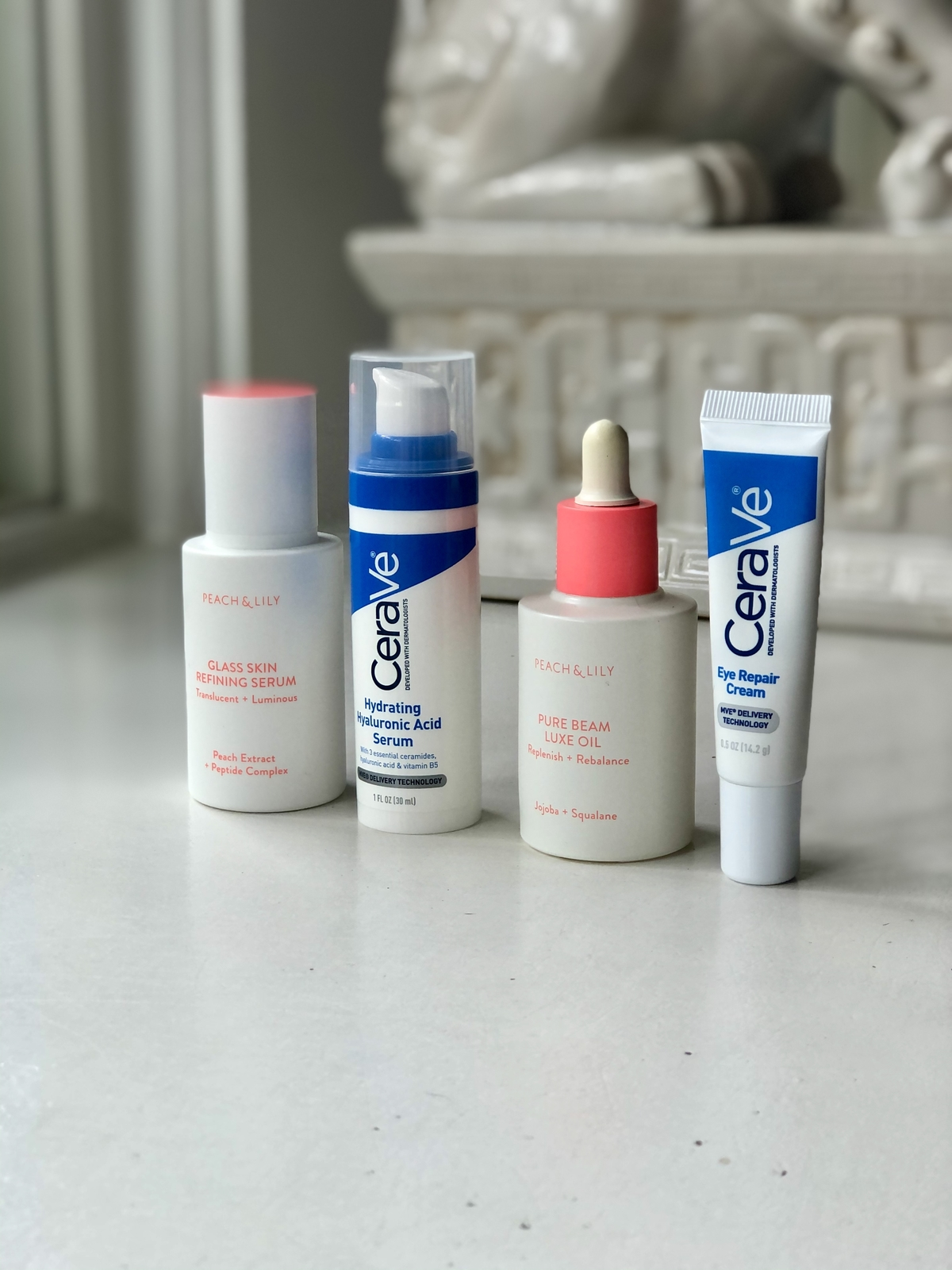 My current no-moisturizer summer skincare routine using two different-textured serums, an oil and an eye cream