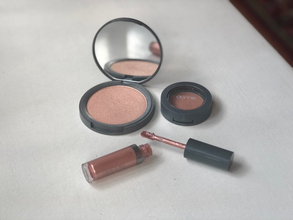 Products from indie beauty brand Dome Beauty, including a liquid eyeshadow, powder highlighter and powder blush