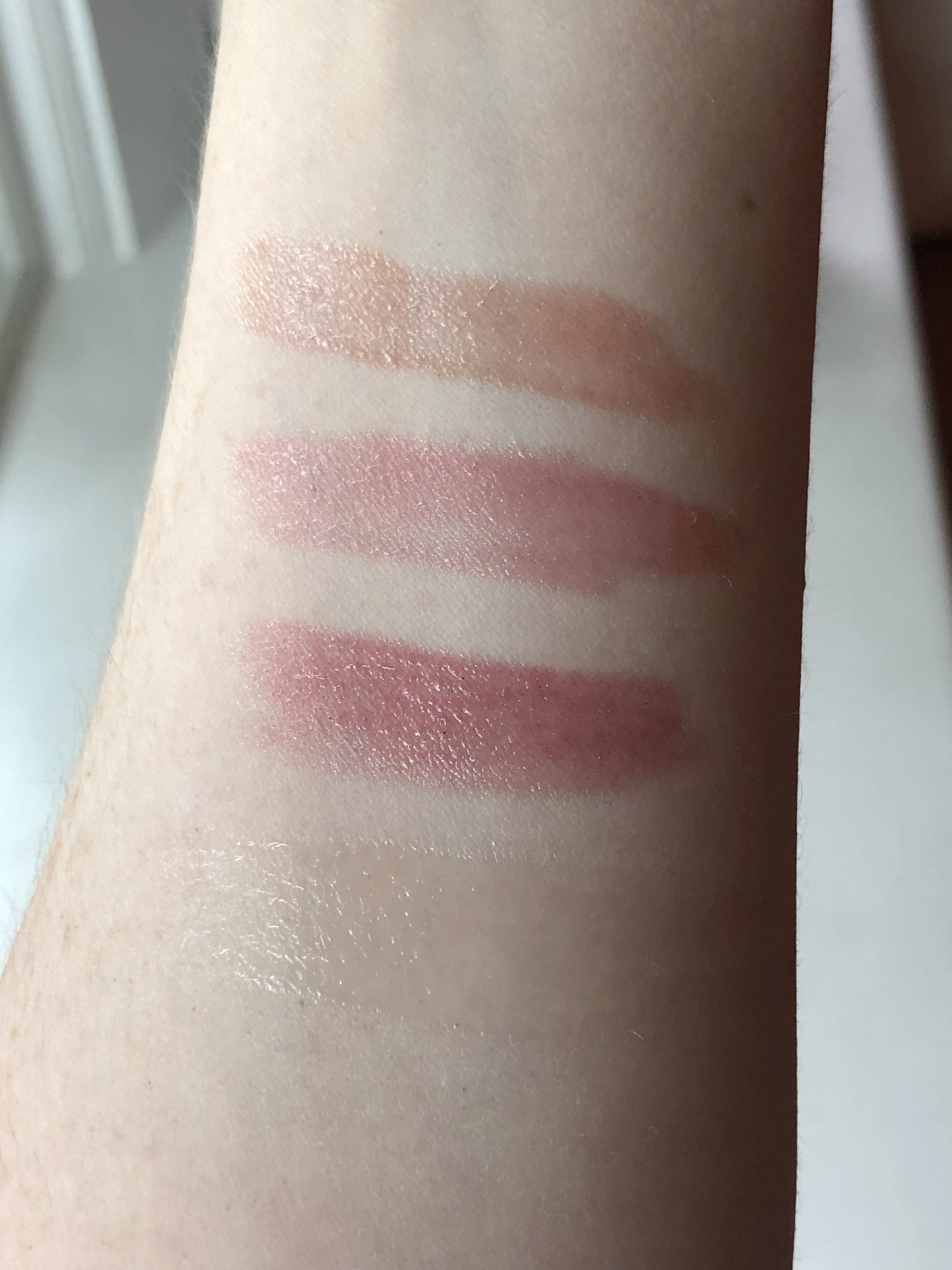 Lip gloss swatches: from top to bottom, Cozy, Blossom, Juneberry, & Dream