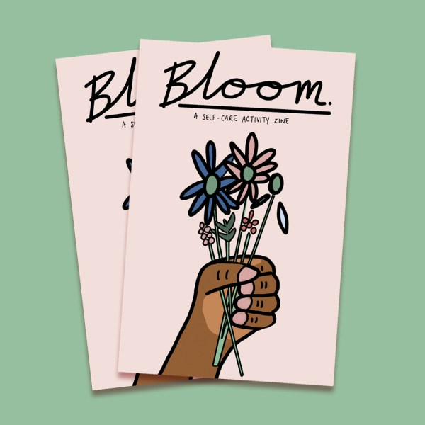 Photo of Bloom zine cover featuring a hand holding flowers