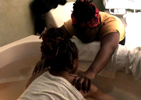 Karasi Doula with client in birthing tub