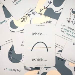 pile of affirmation cards top card reads inhale... exhale...