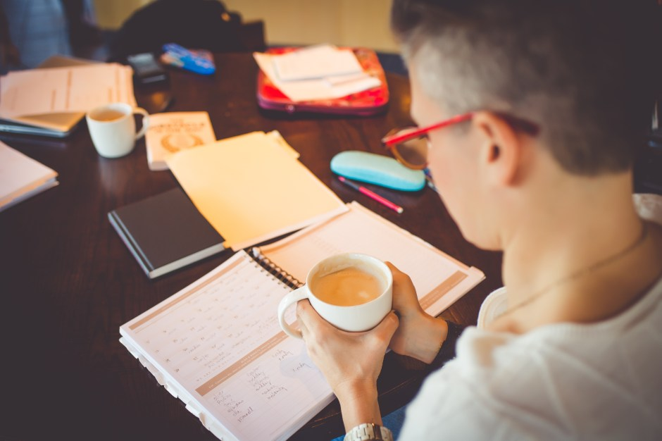 How to maximize your time, entrepreneurs, best day planners, sitting on floor, glasses, coffee, woman on floor, best life organizer, work smarter not harder, time management