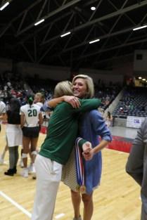 Prosper ISD Athletic Director Valerie Little presents Prosper Assistant Coach Leslie Jackson with her State Championship medal