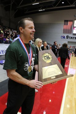 PISD Superintendent Dr. Drew Watkins presents the trophy to the Prosper Lady Eagles.