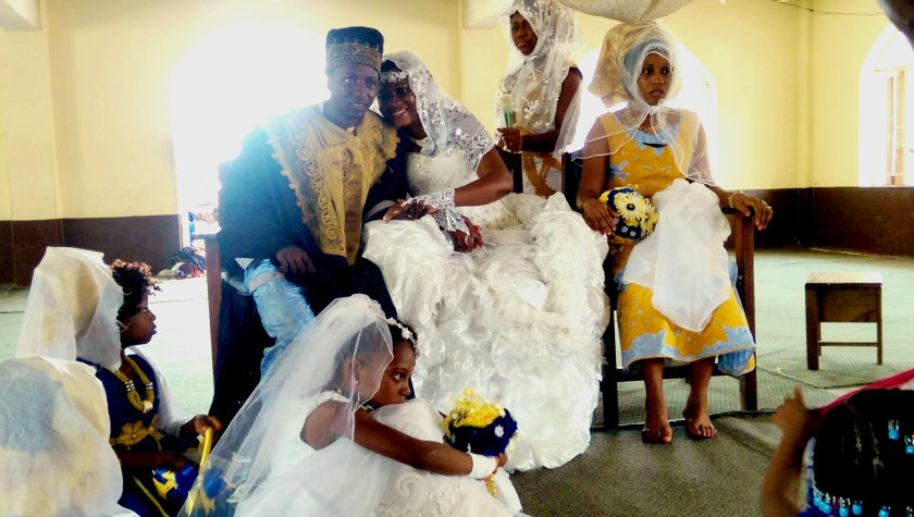 Restless staff member Alpha Jalloh and his bride Baindu in their marriage ceremony at a Mosque in Freetown
