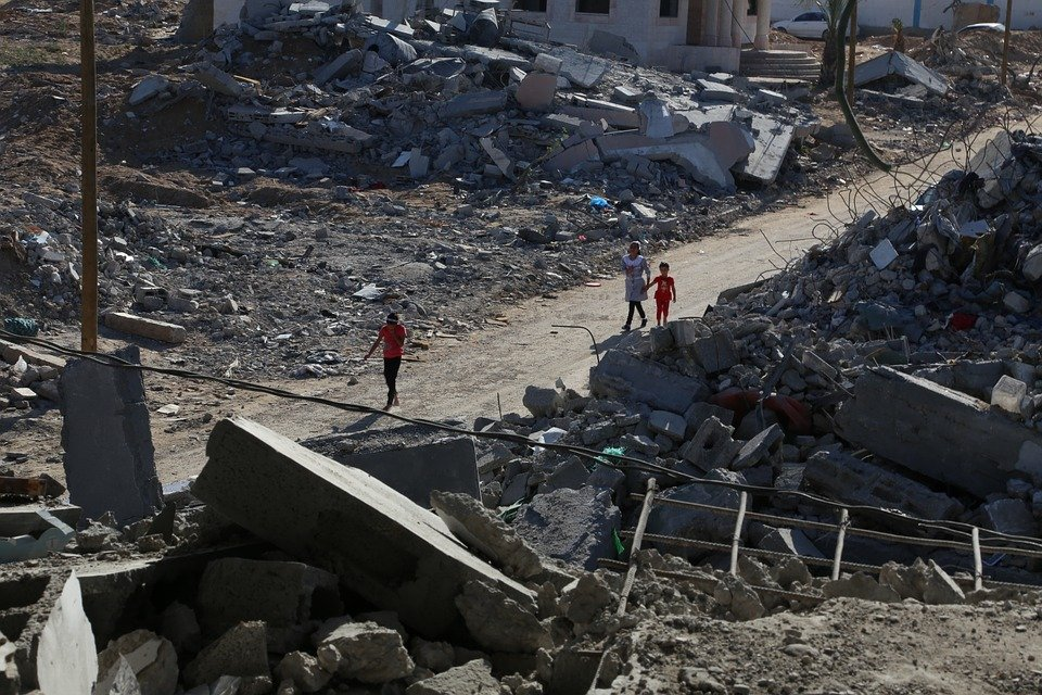 Palestinians caged in Gaza,  living among the destruction.