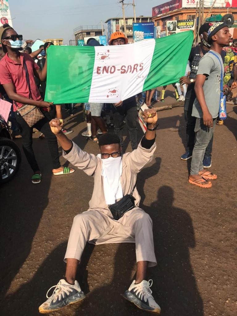 A young protestor at an End SARS protest in Nigeria