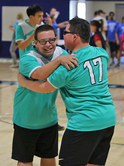 Special Olympics athlete Ryan Schubert (left)