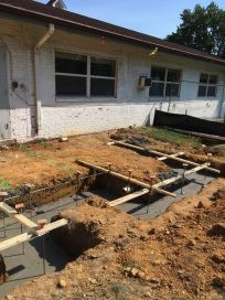 Concrete footer poured for addition.