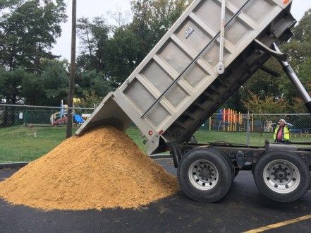 Delivering sand for the brick and masonry work.