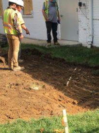 Examining the existing drainage.