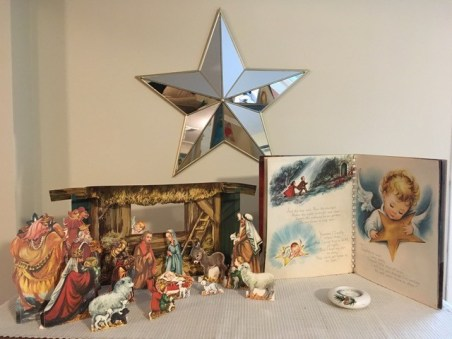 "A story book, ""The Littlest Angel"" was given to me for Christmas when I was 6 or 7. The plot revolves around a little angel who can't get his star shiny enough to be useful to help people find their way. It turns out that his star was the one that lit the way to Bethlehem. The book included a paper manger scene and you can see the tiny angel peeking in the stable window. My mother used to set this up on top of the piano, with the result that whenever you played the piano, the paper people fell over. Mom would then use a choice non-church expletive, ""s***!"" and set the thing up again. (She never said ""d***!"" because she considered it blasphemy.) This year, I decided to set up all the Christmas decorations I could find, since I won't have visits to or from faraway relatives to prepare for. I have had similar challenges getting the pieces to stay up, but rearranging them gives me a chance to reflect on the Nativity and the joy of Christmas, and to remember Christmases past. Betsy A."