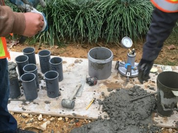 Engineers taking samples of concrete for strength
